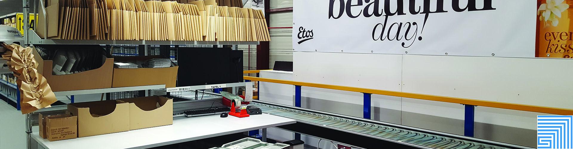 Sovella Nederland Treston inpaktafel met motorische rollenbanen voor webshop etos